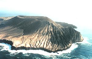 Revillagigedo Islands - Montículo Cinerítico (front) and Bárcena (behind), volcanic cones on San Benedicto, one of the Revillagigedo Islands. Bárcena has existed only since 1952.