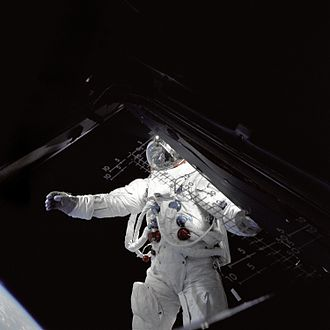 Rusty Schweickart - Schweickart performs an EVA standing on the Lunar Module porch, photographed by fellow astronaut James McDivitt inside the LM.