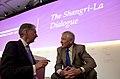 Secretary of Defense Chuck Hagel speaks with British Minister of Defense Philip Hammond.jpg