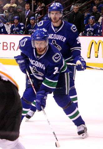 King Clancy Memorial Trophy - Daniel Sedin (front) and Henrik Sedin (back), both 2018 winners; Henrik is also the 2016 winner, and is the only player to have won more than once.