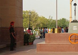 Amar Jawan Jyoti - Indian Army soldier guarding Amar Jawan Jyoti.