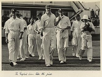 Douglas Jardine - The England side emerging onto the field during the first Test at Brisbane in 1928–29. Jardine is third from the right.