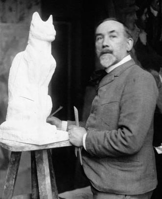 Theophile Steinlen, sculpting a cat in 1913. Steinlen 1913.jpg