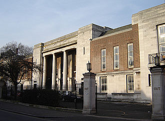 Metropolitan Borough of Stoke Newington - Old Stoke Newington Town Hall. An austere building (perhaps reflecting local nonconformist traditions) compared with those of nearby boroughs like Shoreditch. (January 2006)