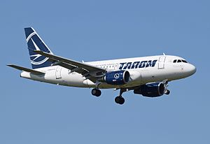 TAROM A318-100 (YR-ASD) arrives London Heathrow 15Sep2015 arp.jpg