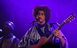 Tinariwen - Ibrahim Ag Alhabib performing with Tinariwen in Vienna during 2011