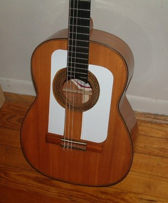 Flamenco guitar - Example of a cedar top flamenco guitar with traditional tap plates/golpeadores installed