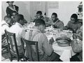 The Negro tenants and neighbors eating dinner after the whit... (3109741227).jpg