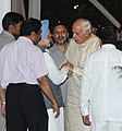 The Prime Minister, Dr. Manmohan Singh meeting the Union Minister for New and Renewable Energy, Dr. Farooq Abdullah at an Iftar party, hosted by him, in New Delhi on September 08, 2010.jpg