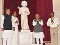The Prime Minister, Shri Narendra Modi unveiled a statue of Sri Sathya Sai Baba, at the inauguration of Sri Sathya Sai Sowbhagyam and Sri Sathya Sai Sanjeevani Centre for Child Heart Care at Naya Raipur, in Chhattisgarh.jpg