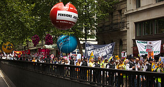 National Union of Teachers - Striking teachers and public sector workers march down the Kingsway, London, flanked by police on 30 June, as part of the 2011 United Kingdom anti-austerity protests.