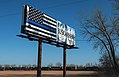 Thin Blue Line Blue Lives Matter Flag and Busch Beer Advertisement Billboard, Dilworth, Minnesota (27757345678).jpg