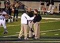Tim Beckman, Dan Hawkins, and Bob Davie in 2009.jpg