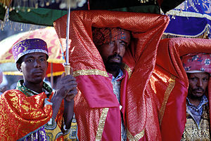 Tabot - A priest carrying a covered tabot on his head during a Timkat (Epiphany) ceremony in Gondar, Ethiopia