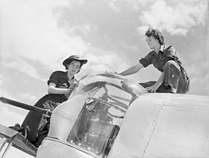 RAAF Station Tocumwal - Two members of the Women's Auxiliary Australian Air Force working on a B-24 Liberator at Tocumwal in 1944