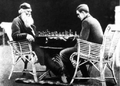 Tolstoy playing chess with the son of Vladimir Chertkov.png
