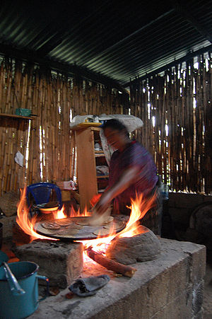 Cook stove - cooking tortillas (flatbread) on a wood-fired 3-stone stove