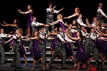 A show choir competing on stage