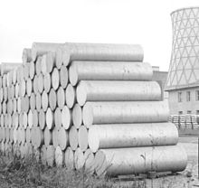 Extrusion billets of aluminium piled up before a factory