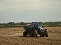 Tractor fertilizing a field in Brittany.jpg