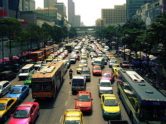 Transport in Thailand - A large number of buses, minibuses and taxis share the streets with private vehicles at Ratchadamri Road, Bangkok.