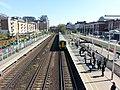 Train coming in Kensington (Olympia) station.jpg