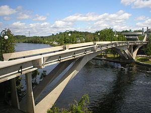 Trent University - A view of the Faryon footbridge that connects the east and west parts of the college across the Otonabee River.