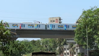 Andheri - A metro train arriving at the DN Nagar station during the Line 1 trial run in May 2013.