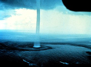 Waterspout - A waterspout near Florida. The two flares with smoke trails near the bottom of the photograph are for indicating wind direction and general speed.