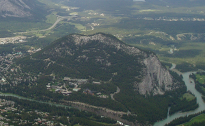 Tunnel Mountain - Tunnel Mountain seen from Sulphur Mountain, with Bow River in foreground and the CP railway and Trans-Canada Highway in the background