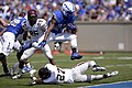 U.S. Air Force Academy (USAFA) running back Jon Lee, center, leaps into the end zone for a touchdown during a game against the Colgate University Raiders at Falcon Stadium in Colorado Springs, Colo., Aug. 31 130831-F-ZJ145-528.jpg