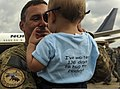 U.S. Air Force Senior Airman Thomas Hole, a crew chief assigned to the 19th Aircraft Maintenance Squadron, holds his son May 20, 2013, at Little Rock Air Force Base, Ark., after returning from a deployment to 130520-F-ZV089-536.jpg