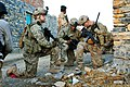 U.S. Army Capt. Lou Cascino, left, pulls security while Staff Sgt. Eric Stephens, center, and 1st Lt. James Kromhout verify their position during a partnered patrol in the village of Madi Khel in the Khowst Pro 131020-A-QG286-010.jpg