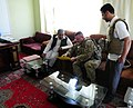 U.S. Army Lt. Col. Anthony Ulrich, center, the civil affairs commander with the Farah Provincial Reconstruction Team (PRT), discusses security with Abdul Ghafaar, left, the chief prosecutor in Farah 120829-N-II659-1163.jpg