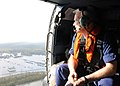 U.S. Coast Guard Rear Adm. Roy Nash, the commander of Coast Guard District 8, scans outside the door of a helicopter on a survey flight of impacted areas of New Orleans Sept 120901-G-HE371-004.jpg