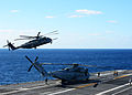 U.S. Marine Corps CH-53E Super Stallion helicopters assigned to Marine Heavy Helicopter Squadron (HMH) 361 and HMH-465 land on the flight deck of the aircraft carrier USS Ronald Reagan (CVN 76) in the Pacific 131206-N-FN963-265.jpg