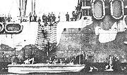 U.S. Marines enter a landing boat in the Fiji Islands, 26 July 1942