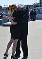 U.S. Navy Machinist's Mate 3rd Class Mack Easley, right, is welcomed home by his wife, Crystal, after the attack submarine USS Alexandria (SSN 757) returned to Groton, Conn., April 3, 2013, from a six-month 130403-N-TN558-044.jpg