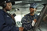 U.S. Navy Seaman Natalie Parker, left, instructs Midshipman 1st Class Ericka Sample, a student at the U.S. Naval Academy, in helmsmen watch procedures aboard the aircraft carrier USS Nimitz (CVN 68) June 23 130623-N-IB033-164.jpg
