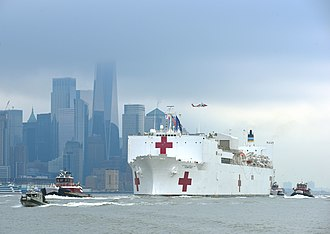 The hospital ship USNS Comfort arrives in Manhattan on 30 March. USNS Comfort New York City 2020.jpg
