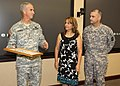 US Army 51731 Lt. Gen. Kevin T. Campbell, commanding general, USASMDC-ARSTRAT, speaks to the commitment of the family during a ceremony in which Staff Sgt. De Leon (far right)received the Bronze Star for his recent.jpg