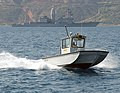 US Navy 020830-N-0780F-006 A Naval Support Activity patrol boat keeps watch over harbor activities in Souda Bay, Crete, Greece.jpg