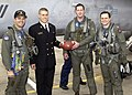 US Navy 021219-N-1374S-002 Naval Academy Quaterback Craig Candeto presents the game ball from the Army-Navy game.jpg