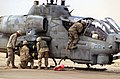 US Navy 030414-M-5654R-026 Weapons are loaded onto an AH-1A Cobra lands for a refueling near Tikrit, Iraq where Marine Wing Support Squadron Three Seventy Three (MWSS-373) has set up a Forward Arming Refueling Point (FARP) in s.jpg