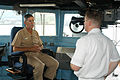 US Navy 030919-N-7217H-004 Journalist 2nd Class Christian Marquardt of American Forces Network interviews Vice Adm. Lafleur, Commander, Naval Surface Force Pacific aboard USS Safeguard (ARS-50).jpg