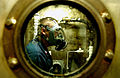 US Navy 040211-N-9769P-080 During a Chemical, Biological, and Radiological (CBR) drill, Damage Controlman 2nd Class Jim Castillo simulates being contaminated and is sprayed with salt water in one of USS John C. Stennis's (CVN 7.jpg