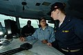 US Navy 040605-N-6213R-028 Quartermaster 3rd Class Melissa Reyes, left, of Chicago, Ill. explains plotting the ship's location on an operation area chart to Midshipman Holly Grachek of White Bear Lake, Minn.jpg