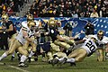 US Navy 041204-N-2383B-224 Navy quarterback leaps for more yardage during 105th Army Navy game.jpg
