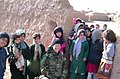 US Navy 050105-N-0000X-082 Cmdr. Kim Evans stops to take a photo with children from the Ghoryan District. Evans is the first female commanding officer of a Provincial Reconstruction Team in Afghanistan.jpg