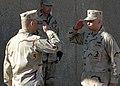US Navy 050216-N-0577F-003 Cmdr. L. V. Cariello, right, salutes Cmdr. J. W. Korka, assuming control of Camp Knott in Fallujah, Iraq.jpg